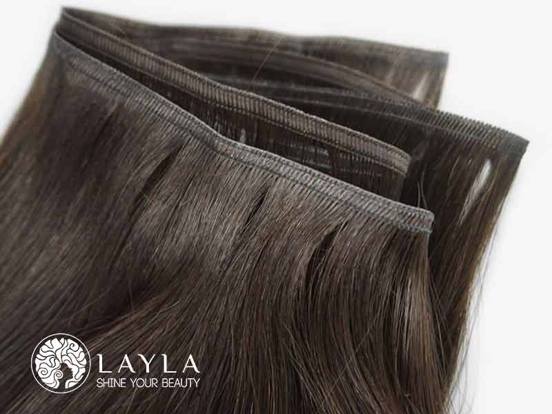 Put on micro-sealed flat hair weft with tapes For example, tape adhesive can hold your ultra-thin hair system for a month. Just fasten the tapes to the seam of the hair extension and then attach the hair in your natural locks. Now, you can enjoy your beautiful hair all day and night.